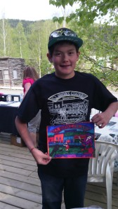 Young volunteer with his coloured book cove